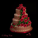 wedding cake with red roses and lace