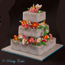 wedding cake with various flowers